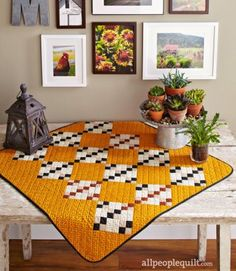 Nine-Patch blocks —made up of Four-Patch units and squares— are set on point across a Cheddar print field to create a geometric treat for the eye. Free pattern from All People Quilt Table Topper Patterns, Quilted Table Toppers, Table Runner Pattern, Quilted Table Runners, Flannel Quilts, Fall Quilts, Small Quilt Projects, Quilting Projects, Sewing Projects
