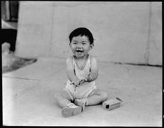 """Little evacuee"", Manzanar Relocation Center, 2 July 1942, Dorothea Lange, public domain via Wikimedia Commons."