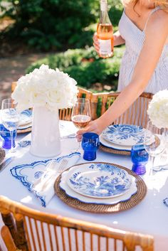 Gal Meets Glam Contributor Series: A Chic Fourth of July Table - Aerin x William Sonoma salad plates & dinner plates, Juliska napkins, Aerin x William Sonoma chargers & Blue tumbler glasses