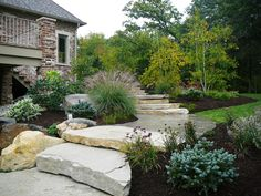 """Large outcropping stone placed within small gardens create this grand staircase. I love how each little """"side"""" area is treated as it's own garden space."""
