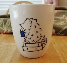 Coffee Mug: Hedgehog with a bestseller - Anybody looking for a christmas gift for me? lol