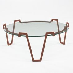 JEAN ROYÈRE    coffee table    France, 1955  enameled iron, glass  32.5 dia x 12.5 h inches