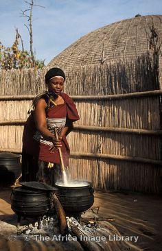 Married Swazi woman preparing porridge, Matsamo village, Swaziland