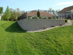 Slopes in the yard would have made installing a pool difficult. Adding a retaini. - Slopes in the yard would have made installing a pool difficult. Adding a retaining wall helps level - Sloped Yard, Sloped Backyard, Backyard Pool Designs, Pool Backyard, Backyard Ideas, Patio Ideas, Swimming Pool Landscaping, Pool Fence, Backyard Landscaping
