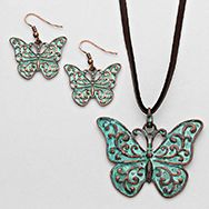 Antique turquoise finish butterfly pendant and earring set. rope-the-moon.com