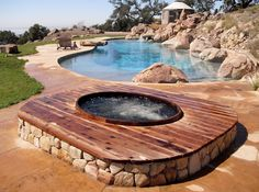 The most beautiful pool and spa landscaping idea includes a custom Gordon & Grant redwood hot tub and decking.