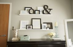 Use Ikea picture ledges to create your own personal gallery wall.