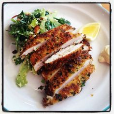 Panko & citrus crusted chicken schnitzels with crunchy celery & Parmesan salad