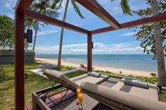 Hotels & Resort, Interesting Open Wooden Panelling Floor Beach Hut With Lounge Chairs Green Grass Coconut Tree Beach Sand And Beautiful The Blue Sea View: Beach Villa Design in Open and Natural Concept besides Sea Panorama
