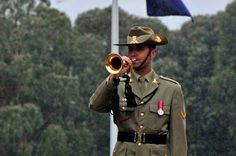 RMC Band Bugler, LCPL Glasson, plays Reveille during Her Majesty The Queen and The Duke of Edinburgh's visit to the Australian War Memorial.