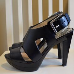 "MICHAEL by Michael Kors Heels Black leather heels. Size 7.5M. Approx. heel hight 4.5"" with a 1.5"" platform. Total heel height including platform is approx. 3"". These shoes are very comfortable and in EXCELLENT used condition. The only visible sign of wear is a tiny rock stuck in the sole (see pictures). If you have questions or want to see additional pictures, feel free to ask. These shoes DO NOT come with original box. MICHAEL Michael Kors Shoes Heels"