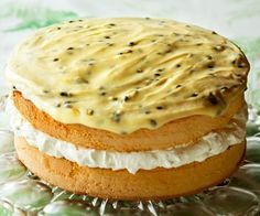 Feather sponge cake with passionfruit icing recipe - By FOOD TO LOVE, Feather sponge filled with clouds of whipped cream and topped with passionfruit icing.