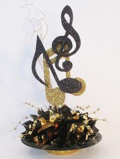 This centerpiece includes: record base with metallic tissue 3 large musical notes