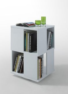 """Modrest Edifice Modern White Lacquer Magazine Rack. The Edifice Modern White Lacquer Magazine Rack presents two cubes with one cube placed on top of the other. Each side of the cube is left open that serves as an open shelf to house books and magazines, while the top can be used like any other table top. It stands on a flattened round hydraulic stainless steel base that allows for the magazine rack to rotate. Dimensions: W20"""" x D20"""" x H31"""" Color: White Finish:   - Discontinued - Price…"""