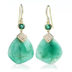Large organic teardrop shaped emeralds are secured by triangle of 18k yellow gold with 21 pave set large white full cut diamonds. An additional large round bezel set emerald balances the top and connects the 18k Yellow gold french wires to this stunning piece. #65allure #emerald #earrings #diamonds