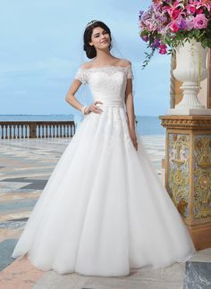 Sincerity wedding dress style 3836 Tulle, satin, and alencon lace ball gown embellished by a off the shoulder neckline