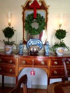 topiaries and silver on sideboard