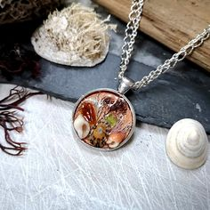 This beach inspired Irish Sea Garden Necklace is a wearable terrarium which contains beautiful Irish sea treasures, encased in resin. Rustic, romantic and earthy. I know that so many people, like me, feel the call of the sea and the salty breeze in their soul. My aim is to bring a little slice of that romantic ocean es Sea Glass Jewelry, Jewelry Box, Jewellery, Bohemian Style Clothing, Boho Style, Irish Sea, Beach Accessories, Double Chain, Boho Look