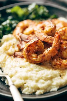 Shrimp and cauliflower mash on a plate with a fork.
