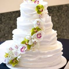 Four-tiered wedding cake and sugar flowers