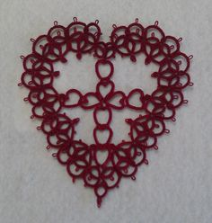 Nice tatted Cross Your Heart motif. Altho' pattern not given, source (book) & other links provided.