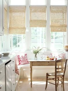 Beautiful Kitchen Dining...charming window seat, country table & chairs...Love the windows & all the natural light..& Love the Bamboo blinds!