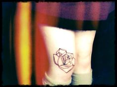 black ink rose tattoo