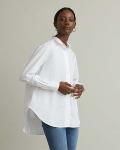 A timeless crisp cotton poplin shirt that can instantly elevate any pair of jeans. Featuring a modern relaxed silhouette for the most effortless look. Spread collar Button front Tonal logo embroidered at front Rounded hem Fashion Silhouette, White Shirts, Modern Fashion, Designing Women, Poplin, Chef Jackets, Capri, Fashion Accessories, Apothecary
