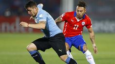 Chilean striker Eduardo Vargas (R) fights for the ball with Uruguayan midfielder Cristian Rodriguez during the Copa America 2015 quarter-finals soccer match between Chile and Uruguay, at Estadio Nacional Julio Martinez Pradanos in Santiago de Chile, Chile, 24 June 2015. EFE/Javier Valdes