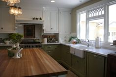 {via Hooked on Houses, Dorie's Charming 1916 Bungalow in AZ} love the mix of green and white cabinets