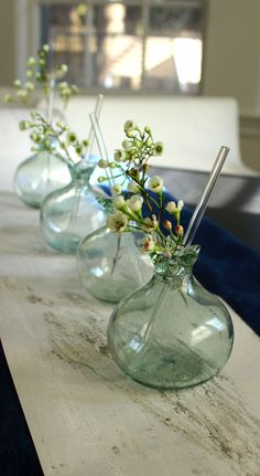 Be ready for spring! Vase or glass? Both work and this hand-blown glass comes with the cutest straw.