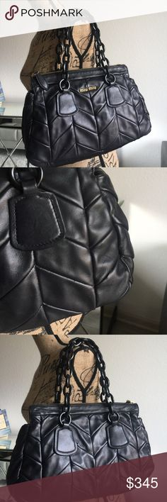 100% Authentic miu miu black quilted bag. These gorgeous bag comes from my collection. 100% Authentic.   The handles are ceramic pieces.  Comes with a dust bag. It has signs of wear as seen in pictures. Some scratches on the front right side of the bag.  Refer to pics. The interior lining has some small white spots.  The bag is pretty roomy and has a big zippered pocket.  Stands at 9 inches without strap. With handle strap 18 inches tall with handle strap.  Wide at the bottom at 14 inches…