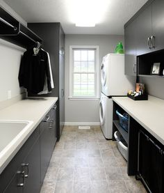 Laundry room with clothing rod. Add a wine rack and its the perfect room! ;)