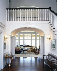 i like the view from the front doo and how you pass the stairs to enter the family space