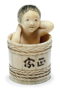 An Ivory Netsuke   Signed Soko, Meiji Period (late 19th century)   Of a child taking a bath in a barrel, So School