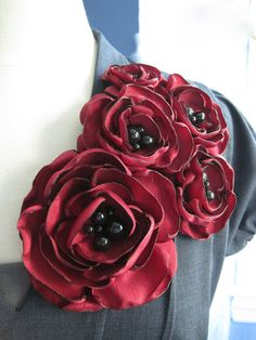 Quintuple-bloom, fabric flower brooch in a wonderfully textured, matte-satin finish shantung makes a classicly styled corsage with a bold