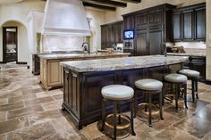 Tuscan Transitional Home by Jauregui Architect. Huge Kitchen