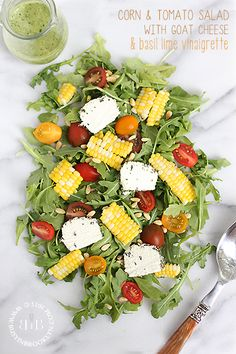 Corn and tomato salad with goat cheese and basil lime vinaigrette