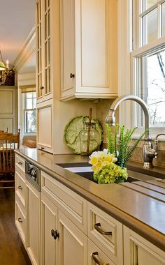 caesarstone counter-This Old House - West Newton Hill Kitchen - traditional - kitchen - boston - Venegas and Company- Cream Kitchen Cabinets, Beige Cabinets, Kitchen Cabinet Colors, Painting Kitchen Cabinets, Kitchen Colors, Kitchen Faucets, Floors Kitchen, Kitchen Counters, Cream Cupboards