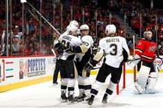 November 7, 2015 at Calgary: Phil Kessel celebrates with his teammates after scoring his second goal in as many games, giving him a team-leading six on the season . Final score, 5-2 Flames.