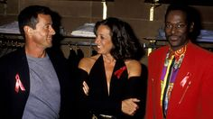 Sylvester Stallone, Donna Karan, and Luther Vandross, 1992, at a Donna Karan cocktail party Getty Images  - HarpersBAZAAR.com