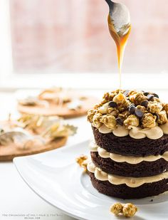 double chocolate  cake with salted caramel cream cheese frosting, chocolate chips & caramel popcorn