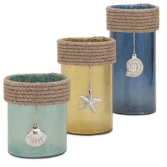 Add fresh coastal style with this set of three Sea Coast Glass Candle Hurricanes in blue, green and yellow with nautical feel rope-wrapped openings and delicate shiny sea shell and starfish charms. A wonderful gift for moms! Dollar Store Crafts, Crafts To Sell, Diy And Crafts, Seashell Crafts, Beach Crafts, Mason Jar Crafts, Bottle Crafts, Coastal Style, Coastal Decor