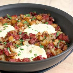 Baked Eggs with Corned Beef Hash - Emeril's Book {Recipe -  http://traceysculinaryadventures.com/2011/09/baked-eggs-with-corned-beef-hash.html}