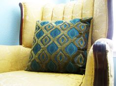Peacock Pillow on Gold Wingback Chair...heavenly.
