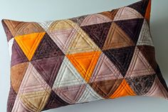 Quilted lumbar pillow cover in triangle patchwork by Jana Dohnalová
