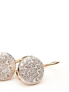 This earring is a flawless update on the classic diamond earring. The earring is made of 18kt rose gold with a french wire back for security. On display are round discs paved in white diamonds, 0.78 ct.