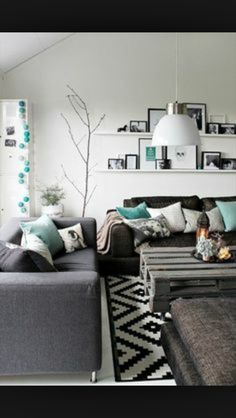 charcol sofa, black, white and turquoise.