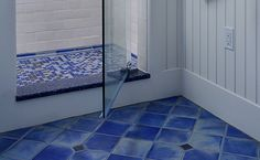 blue floor in white bathroom