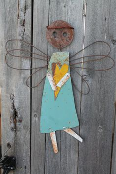 large wall decor hanging angel made from metal scraps and found objects....I sooooooooo want this!